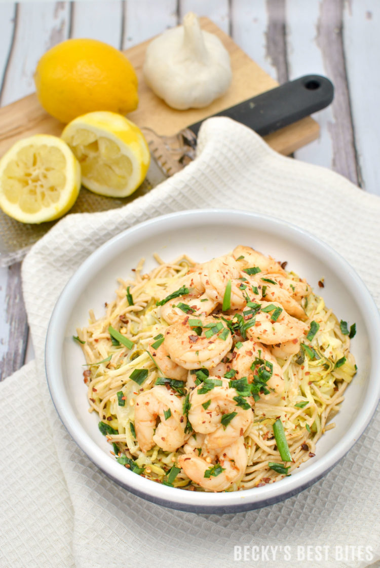 Easy Shrimp Scampi with Zoodles and Noodles is an easy and healthy weeknight dinner recipe. Introduce your family to healthier zucchini noodles by adding them to regular whole grain pasta for a fun way to add more veggies to their diets! | beckysbestbites.com