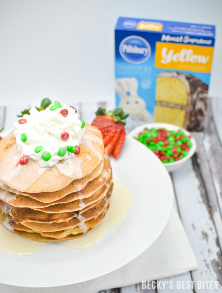 M&M's Christmas Cake Pancakes are a yummy treat for a holiday morning or brunch! A couple of healthier swaps, like applesauce, almond milk and greek yogurt balance these sweet surprises that kids of all ages will love! #ad #holidaybaking | beckysbestbites.com