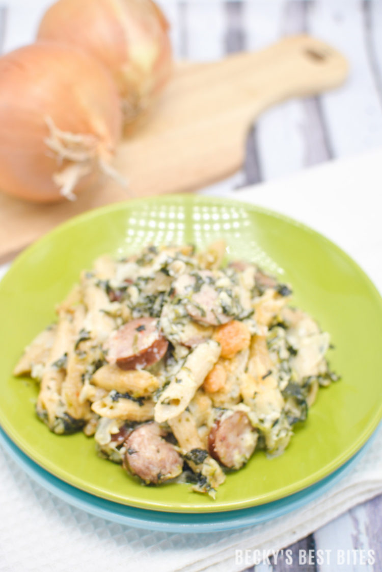 Spinach Alfredo Pasta Bake with Sausage is an easy weeknight dinner recipe made with a healthy and lighter version of the classic alfredo sauce usingno butter, heavy cream or cream cheese. | beckysbestbites.com