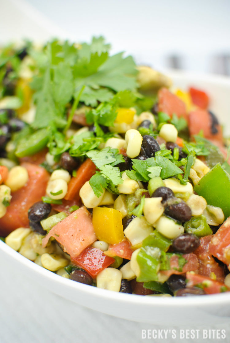 Southwest Black Bean and Corn Salad / Salsa is a beautiful, quick and easy side dish for grilled meats. Use as an healthy appetizer for a game day spread.   beckysbestbites.com
